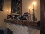 Old photos and bleeding candles on the mantel